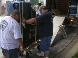 Gerber's Kansas City Piano Mover team loading a piano on a truck